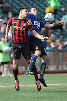 Frederic Veseli (left) battles against Matias Vuoso (right) for the ball. Manchester City defeated Club America 2-0 in the Herbalife World Football Challenge 2011 at AT&T Park in San Francisco, California on July 16th, 2011.
