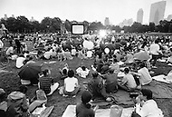 July 24, 1969., Central Park, New York, USA --- Crowds Waiting to Watch the landing of Apollo XI mission on the moon. A storm forced an end to the public broadcast and the crowds went home to watch the landing from their own TVs around 8pm.