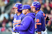Third baseman Patrick Cromwell (25) of the Clemson Tigers, left, confirms with head coach Monte Lee, center and Logan Davidson in the ninth inning in the Reedy River Rivalry game against the South Carolina Gamecocks  on Saturday, March 4, 2017, at Fluor Field at the West End in Greenville, South Carolina. Clemson won, 8-7. (Tom Priddy/Four Seam Images)