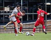 John Snyder (22) of Georgetown tries to climb over the back of Jack Bennett (11) of St. John's as Danny Bedoya (20) closes in during the game at North Kehoe Field in Washington DC. Georgetown defeated St. John's, 2-1, in the Big East conference tournament quarterfinals.
