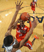 Feb. 2, 2011; Charlottesville, VA, USA; Clemson Tigers guard Demontez Stitt (2) is defended by Virginia Cavaliers guard Jontel Evans (1) during the game at the John Paul Jones Arena. Virginia won 49-47. Mandatory Credit: Andrew Shurtleff