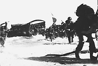 American troops of the 163rd Inf. Regt., hit the beach from Higgins boats during the invasion of Wadke Island, Dutch New Guinea.  May 18, 1944.  Lt. Kent Rooks.  (Army)<br /> NARA FILE #:  111-SC-190968<br /> WAR &amp; CONFLICT BOOK #:  1173