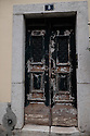 Lisbon, Portugal. 15.04.2016. Old, weathered door in the district of Alfama. Photograph © Jane Hobson.