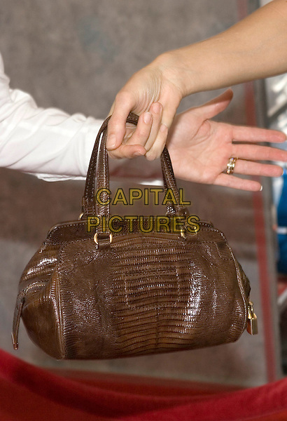 """KELLY PRESTON'S PURSE.Walt Disney Pictures' World Premiere of """"Sky High"""" held at the El Capitan Theatre, Hollywood, California..July 24th, 2005  .Photo Credit: Zach Lipp/AdMedia.bag purse brown leather.www.capitalpictures.com.sales@capitalpictures.com.© Capital Pictures."""