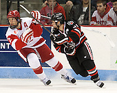Ryan Ruikka (BU - 2), Robbie Vrolyk (NU - 91) - The visiting Northeastern University Huskies defeated the Boston University Terriers 6-5 on Friday, January 18, 2013, at Agganis Arena in Boston, Massachusetts.