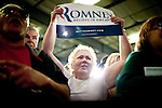 Darlene Olson cheers for GOP presidential candidate Mitt Romney at a campaign rally in Elko, Nevada, February 3, 2012.
