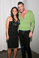 Project Runway fashion designers Ivy Higa and Casanova, pose at the Ivy h. Fall/Winter 2011 collection presentation, during New York Fashion Week Fall 2011.