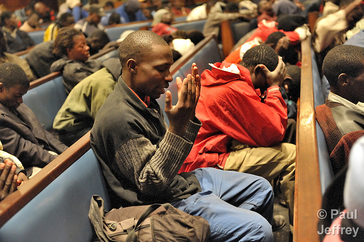 Refugees from Zimbabwe and other African countries gather for evening worship the Central Methodist Church in Johannesburg, South Africa. The church is home to more than 3,000 refugees suffering from economic desperation and sporadic xenophobic attacks.