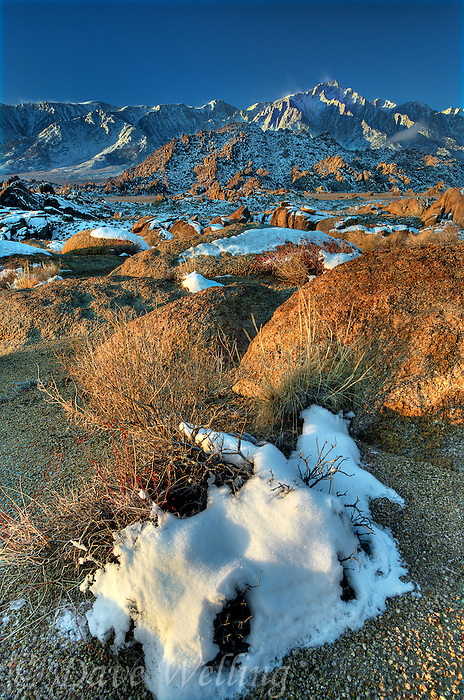 711700280 winter sunrise with snow covered granite boulders in the bureau of land management protected land the alabama hills in the southern section of the eastern sierras with lone pine peak in the background in kern county california