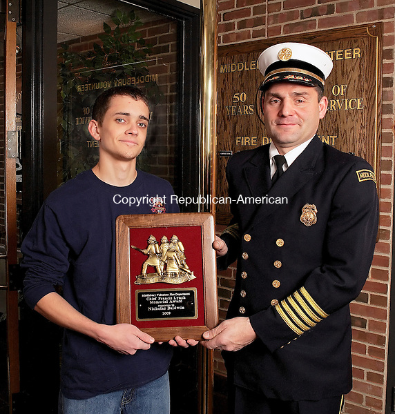 """Middlebury, CT-31, December 2009-123109CM03 -- Middlebury Fire Department's Chief Paul Perrotti (right) stands with Nick Baldwin, 18, of Middlebury . Baldwin was recently awarded the Chief Francis Lynch Memorial Award, aka """"good kid award.""""  Baldwin, a 4th generation firefighter.  The award is presented to a young standout member of the department each year.  Christopher Massa Republican-American"""