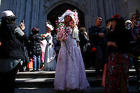 A woman pose for a picture as she takes part during the annual easter parade in Manhattan, New York, 03.27.2016. This annual tradition has been taking place in New York City for over 100 years, Photo by VIEWpress.