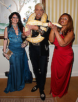 BEVERLY HILLS, CA, USA - MARCH 28: Vikki Lizzi, KUBA Ka, Tina Trozzo at the Versace Unveiling Of The 1st Pop Recording Artist Superhero - KUBA Ka's Performance Outfits. Designed by the legendary fashion hosuse - Donatella Versace. For the Benefit of the Face Forward Foundation (Plastic Surgery for Destroyed Faces from Violence). Pop entertainer TV personality KUBA Ka, together with VERSACE, unveiled Kuba Ka's new Versace images, for the First Pop Artist/Superhero of the World. He has become the inspiration of Donatella's newest and wildest creations and will celebrate the launch of his new power house conglomerate - KUBA Ka Empire Inc. in collaboration with the sensational fashion house - VERSACE on Friday, his birthday at a red carpet media and celebrity event at the luxurious Peninsula Hotel in Beverly Hills held at the Peninsula Hotel on March 28, 2014 in Beverly Hills, California, United States. (Photo by Xavier Collin/Celebrity Monitor)