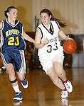 WATERBURY, CT,  02 JANUARY 2006, 010207BZ10- Sacred Heart's Stephanie Kelly (33) drives past Kennedy's Amber Alberto (23) during their game at Sacred Heart High School in Waterbury Tuesday.<br /> Jamison C. Bazinet Republican-American