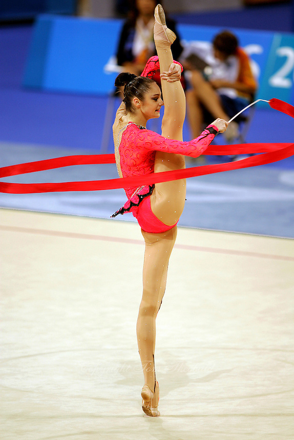Anna Bessonova of Ukraine holds balance with ribbon during All-Around final at 2004 Athens Olympic Games on August 29, 2006 at Athens, Greece. (Photo by Tom Theobald)
