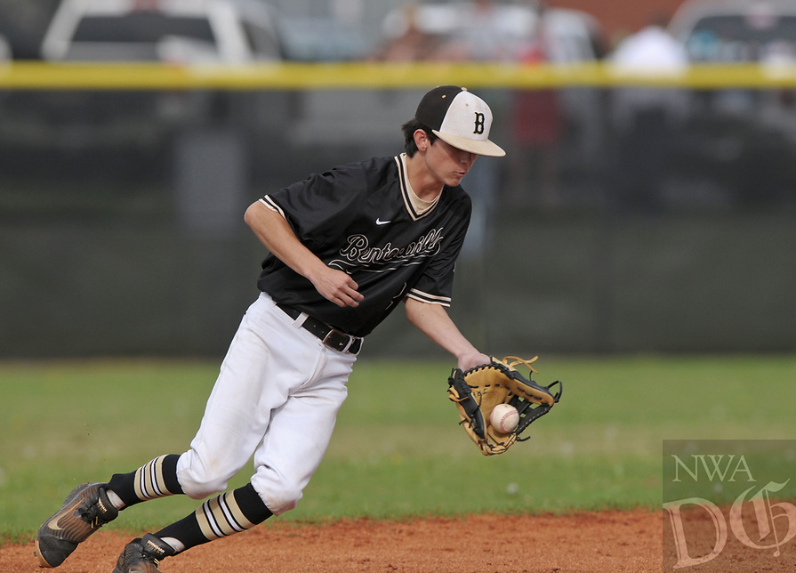NWA Democrat-Gazette/BEN GOFF @NWABENGOFF<br /> Justin Hines, Bentonville shortstop, fields a ground ball for an out Monday, April 17, 2017, during the second inning gainst Rogers at the Tiger Athletic Complex in Bentonville.