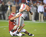 Ole Miss quarterback Jeremiah Masoli (8) is pressured by Alabama defensive lineman Nick Gentry (58) at Bryant-Denny Stadium in Tuscaloosa, Ala.  on Saturday, October 16, 2010. Alabama won 23-10.