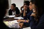 From left: Ishmael Sylla, 18, Jarius Pierre-Toussaint, 18, Kenneth Cruz, 17 and Senior Trainer Gabe Gaskin from the De Pauw Posse 11, work together during a writing workshop at the Posse Foundation in New York, NY on April 01, 2014. Students in the Posse Foundation are chosen as scholars and go through college prep together as seniors in high school then attend the same college campus together where they get ongoing support. The Posse Foundation has identified, recruited and trained 5,544 public high school students with extraordinary academic and leadership potential to become Posse Scholars over the past 25 years.