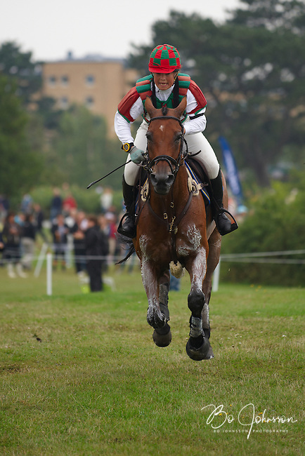 Viktoria Carlerback (SWE) and  Moustic de Canta in the cross country during the FEI Eventing CIC*** at Malmo City Horse Show 2010. <br /> The couple was placed 44th after Friday's dressage, was placed 14th after Saturday's cross country (this pic) and finished as 12th after Sunday's show jumping.<br /> Viktoria and Moustic de Canta finished as 5th in the Swedish Championship, a competition-in-the-competition of the World Cup CIC***.<br /> Eventing in Ribersborg, Malmo, Sweden.<br /> August 2010.<br /> Only for editorial use.