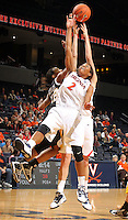 Dec. 18, 2010; Charlottesville, VA, USA; Virginia Cavaliers guard Whitny Edwards (2) reaches for the rebound with UMBC Retrievers guard Kristin Coles (22) during the game at the John Paul Jones Arena. Virginia won 61-46. Mandatory Credit: Andrew Shurtleff-