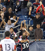 New England Revolution midfielder Diego Fagundez (14) celebrates his goal with teammates.  In a Major League Soccer (MLS) match, the New England Revolution (blue) defeated D.C. United (white), 2-1, at Gillette Stadium on September 21, 2013.