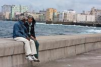 Cuba, Havana.  A Couple Talking on the Malecon on a Winter Day.