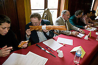 """Jury members examine baguettes competing for the title of Best Baguette in Paris, France, 5 January 2004. 120 bakers competed in the 2004 edition of the prestigious annual Grand Prix de la Baguette. The title went to Pierre Thilloux from """"La Fournée d?Augustine"""" bakery in the 14th arrondissement of Paris."""