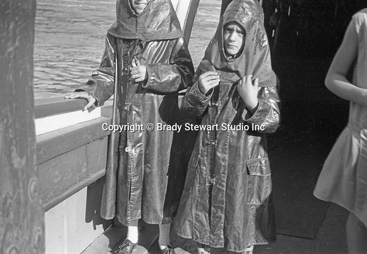 Niagara Falls New York:  Two children wearing rain gear on the Maid of the Mist - 1914