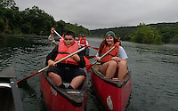 NWA Democrat-Gazette/FLIP PUTTHOFF<br /> Martin Platero (left) and Katie Wagner make their way down the White River. The trip on July 8 2015 was Martin's first time in a boat of any kind.