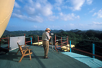 Birdwatcher on the top deck of the Canopy Tower ecolodge in Soberania National Park, Panama