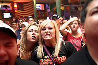 Brittany Busby of Pasadena, TX, watches in anguish as Albert Pujols hits a three-run walk off home run in the bottom of the ninth inning of Game 5 in the 2005 NLCS.