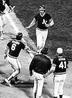 Oakland A's Joe Rudi with game winning walkoff Home Run in the 11th inning.(June 20,1972 photo by Ron Riesterer)