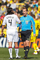 27 MARCH 2010:  Referee Mark Geiger discusses a call with Nick Garcia of Toronto FC (4) during the Toronto FC at Columbus Crew MLS game in Columbus, Ohio on March 27, 2010.