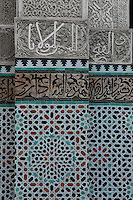 Detail of mosaic in central patio, Bou Inania Madrasa, Fez, Morocco, pictured on February 22, 2009 in the evening. The Bou Inania Madrasa was founded as a boarding school and mosque in AD 1351-56 by Abu Inan Faris, also the founder of the Bou Inania Madrasa in Meknes, and holds the status of Grand Mosque. A fine example of Marenid architecture with its intricate plasterwork, carved cedar and decorated tiles or zellij it is the only mosque in Fez open to non-Muslim visitors. It was renovated in the 18th and 20th centuries. Fez, Morocco's second largest city, and one of the four imperial cities, was founded in 789 by Idris I on the banks of the River Fez. The oldest university in the world is here and the city is still the Moroccan cultural and spiritual centre. Fez has three sectors: the oldest part, the walled city of Fes-el-Bali, houses Morocco's largest medina and is a UNESCO World Heritage Site;  Fes-el-Jedid was founded in 1244 as a new capital by the Merenid dynasty, and contains the Mellah, or Jewish quarter; Ville Nouvelle was built by the French who took over most of Morocco in 1912 and transferred the capital to Rabat. Picture by Manuel Cohen.
