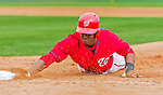 7 March 2015: Washington Nationals outfielder Michael Taylor dives safely back to first during Spring Training action against the St. Louis Cardinals at Space Coast Stadium in Viera, Florida. The Nationals rallied to defeat the Cardinals 6-5 in Grapefruit League play. Mandatory Credit: Ed Wolfstein Photo *** RAW (NEF) Image File Available ***