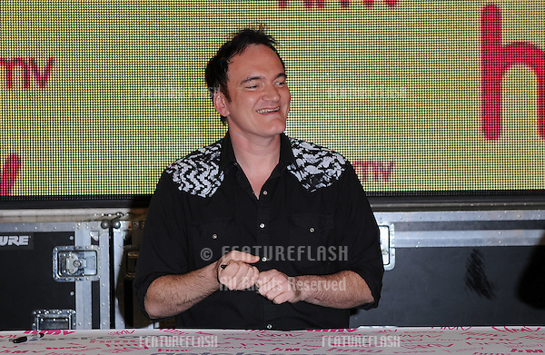 Cult film director Quentin Tarantino meets the fans as he signs copies of limited edition seven inch single of Cat People by David Bowie. Track appears in QT's new film Inglourious Basterds. Picture: Gerard Copper / Featureflash