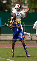 Jose Barralaga (13) of Honduras heads the ball over Zari Prescod (17) of Barbados  during the group stage of the CONCACAF Men's Under 17 Championship at Catherine Hall Stadium in Montego Bay, Jamaica. Honduras defeated Barbados, 2-1.