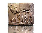 Picture & Image of  Neo-Hittite orthostat describing the legend of Gilgamesh from Karkamis,, Turkey. Ancora Archaeological Museum. To the left a bearded deity with a horned helmet is holding a lions back leg and is about to strike it with an axe. To the right a man is stabbing the lion with a dagger. 5