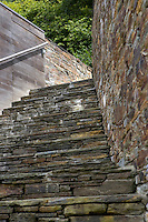 Local stone and traditional methods such as dry stone walling have been used to construct this exterior staircase