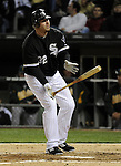 CHICAGO - APRIL 12:  Adam Dunn #32 of the Chicago White Sox tosses his bat after drawing a walk against the Oakland Athletics on April 12, 2011 at U.S. Cellular Field in Chicago, Illinois.  The White Sox defeated the Athletics 6-5.  (Photo by Ron Vesely)  Subject:  Adam Dunn