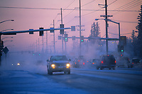 Vehicles drive through ice fog on Peger road in downtown Fairbanks, Alaska