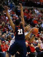 Ohio State Buckeyes forward Marc Loving (2) looks to pass around Illinois Fighting Illini guard Malcolm Hill (21) in the first half at Value City Arena in Columbus Jan. 23, 2013 (Dispatch photo by Eric Albrecht)