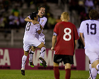 Nathan Smith (4) of the United States celebrates his goal with teammate Esteban Rodriguez during the finals of the CONCACAF Men's Under 17 Championship at Catherine Hall Stadium in Montego Bay, Jamaica. The United States defeated Canada, 3-0, in overtime