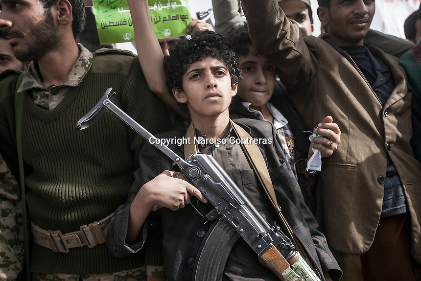 "Friday 10 July, 2015: Houthi militants demonstrate in solidarity with the Palestinian people during the commemoration of ""Al Quds"" as well as against the Saudi-led war of intervention in their country in the capital city of Sana'a. (Photo/Narciso Contreras)"
