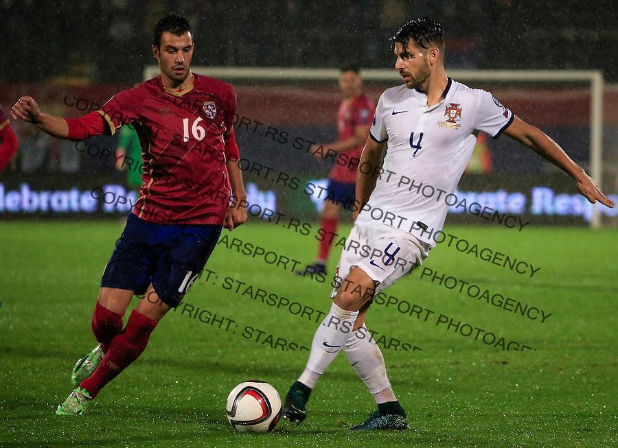 Fudbal, kvalifikacije za UEFA EURO 2016 qualifiers-Qualifying round - Group I<br /> Srbija v Portugal<br /> Luka Milivojevic (L) and Miguel Veloso<br /> Beograd, 11.10.2015.<br /> foto: Srdjan Stevanovic/Starsportphoto &copy;