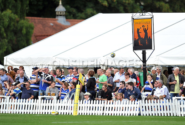 A general view of supporters enjoying the atmosphere in The Swift Half during the match. Pre-season friendly match, between Bath Rugby and the Scarlets on August 16, 2014 at the Recreation Ground in Bath, England. Photo by: Patrick Khachfe / Onside Images