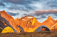 Campsite view of morning light on Xanadu, Arial and Calaban Peaks, in the Arrigetch Peaks, Gates of the Arctic National Park, Alaska.