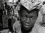 A carrier girl on the market in Lome, Togo