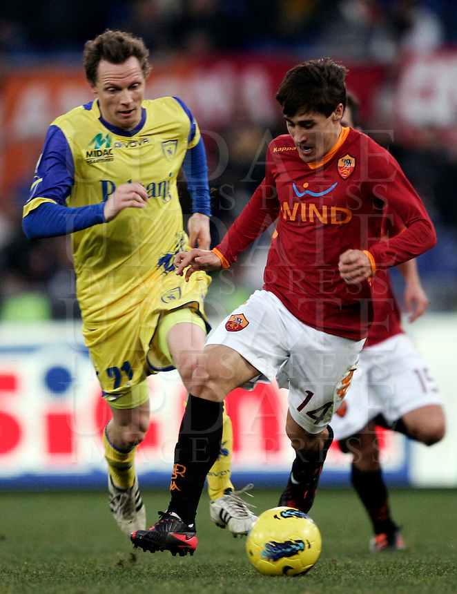Calcio, Serie A: Roma vs Chievo Verona. Roma, stadio Olimpico, 8 gennaio 2012..Football, Italian serie A: Roma vs Chievo Verona. Rome, Olympic stadium, 8 january 2012..AS Roma forward Bojan Krkic, of Spain, is chased by Chievo Verona defender Nicolas Frey, of France, left..UPDATE IMAGES PRESS/Riccardo De Luca