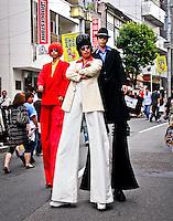 Elvis & friends walk the streets of Sangenjaya, Tokyo during the Street performers festival.