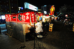 """""""Yatai"""" food stalls, most selling ramen, or noodles served in hot broth, line the Naka River that runs through Fukuoka City, Japan. Fukuoka, which is thought to be Japan's oldest city due to its proximity to China, is famed for its Hakata brand of ramen, a dish that has its origins in China."""